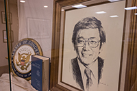 Photo of framed sketch of Norman Mineta