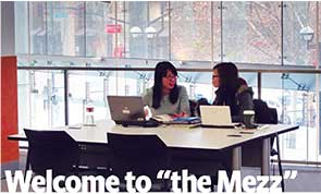 Photo of two students studying in the mezzanine study space.